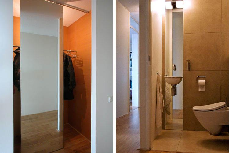 Verschuifbare-spiegel-voor-garderobe-onttrekt-zicht-op-jassenOntwerp toilet in heldere lijnen en naturel tinten