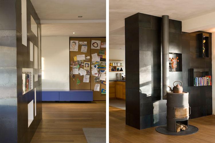 Maatwerk wandkasten zorgen voor lijnenspel tussen woonkamer en keuken - Gietijzeren houtkachel als uitgangspunt betreft materiaalkeuze wandkast