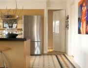 De mozaiekvloer als blikvanger in de keuken. Ontwerp DenkRuim interieurconcepten
